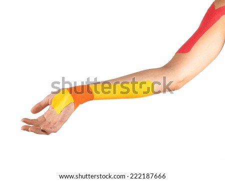 Injured hand therapy with kinesio tex tape. - stock photo