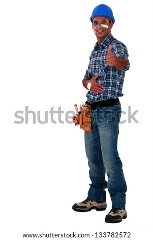 Injured handyman giving the OK gesture - stock photo