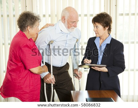 Injured man consulting an attorney about a lawsuit. - stock photo