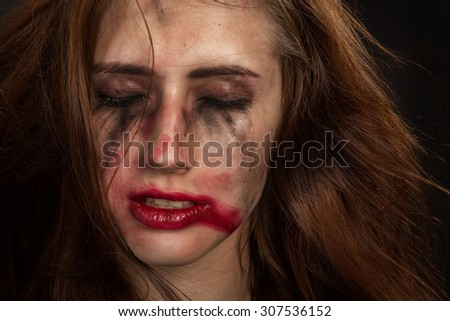 injured woman with smeared makeup - stock photo