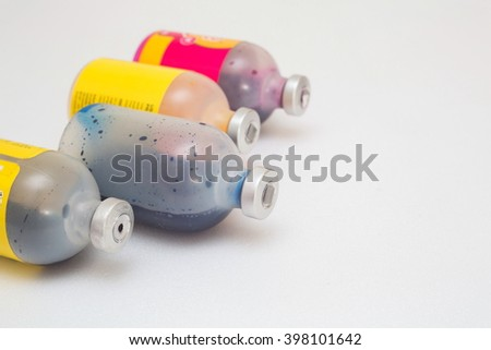 Ink bottle for printer on white background,Hazardous waste concept - stock photo