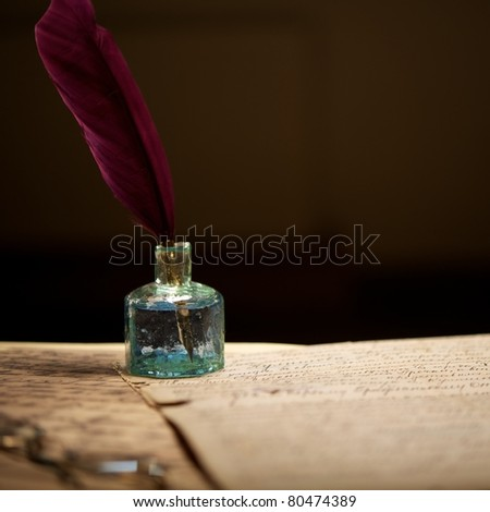 Inkwell on an old letter - stock photo