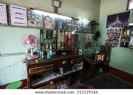 Inle city , Shan state , Myanmar. - 22 February 2015. Atmosphere in barber shop.