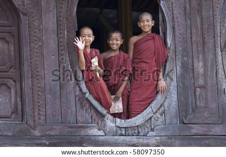 INLE LAKE, BURMA- MAR 15: young monks in Nyaung Shwe Monastery MAR 15, 2010 in Inle lake, Burma (Myanmar). - stock photo