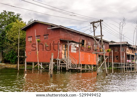 INLE LAKE, MYANMAR - AUG 30, 2016: Houses of the Inpawkhon village over the Inle Sap,a freshwater lake in the Nyaungshwe Township of Taunggyi District of Shan State, Myanmar