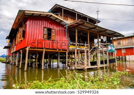 INLE LAKE, MYANMAR - AUG 30, 2016: Nature of the Inpawkhon village over the Inle Sap,a freshwater lake in the Nyaungshwe Township of Taunggyi District of Shan State, Myanmar