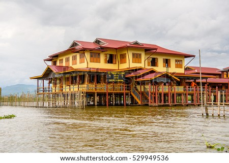 INLE LAKE, MYANMAR - AUG 30, 2016: Wooden house in the Inpawkhon village over the Inle Sap,a freshwater lake in the Nyaungshwe Township of Taunggyi District of Shan State, Myanmar