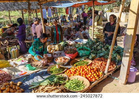 INLE LAKE, MYANMAR - DEC 8: Local traders at 5 Day market on Dec 8, 2014 in Inle. Hand-made goods and food for local use and trading are another source of commerce in Inle. - stock photo