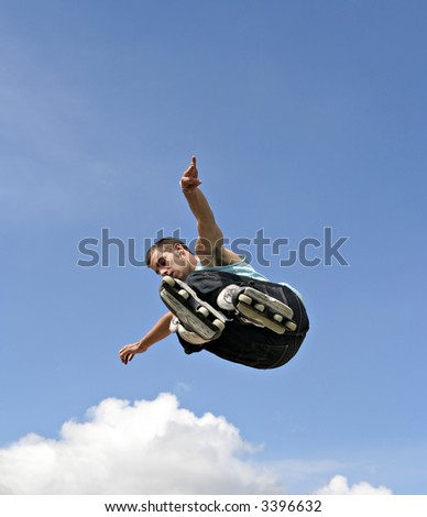 Inline Skater Jumping - Clouds and blue sky, space for text etc. - stock photo