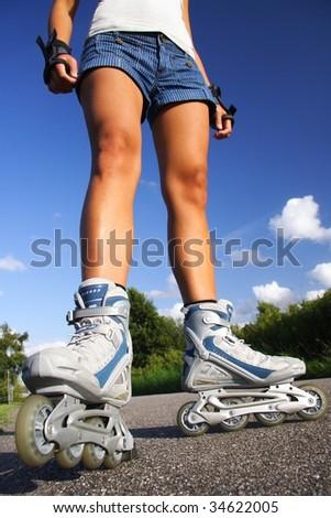 Inline skates. closeup of woman legs and skates. - stock photo