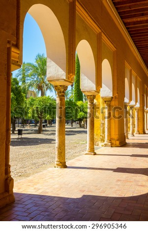 Inner courtyard with columns and arches of the famous mosque of Cordoba, Spain - stock photo