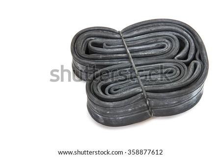 Inner tube for bike isolated on white - stock photo