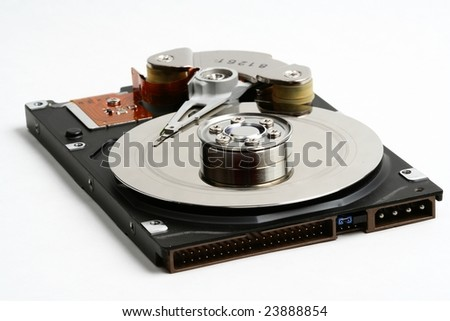 Inner workings of a damaged hard disk, (simulated) head crash. Useful to illustrate the necessity to back up data, data loss and similar concepts. - stock photo