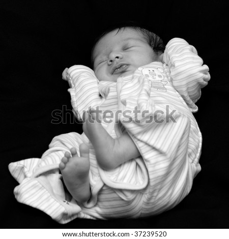 Innocent vulnerable small baby - stock photo