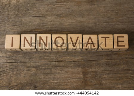 innovate word written on wooden cubes