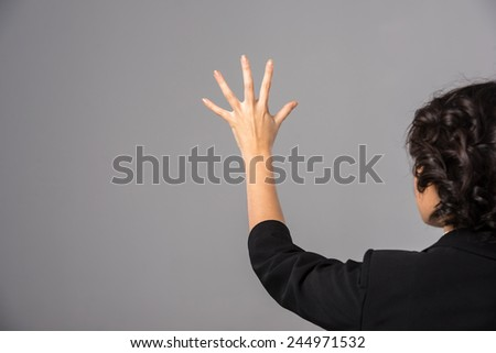 Innovation concept. Young woman is presenting innovation of her own hands. - stock photo