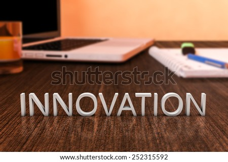 Innovation - letters on wooden desk with laptop computer and a notebook. 3d render illustration. - stock photo