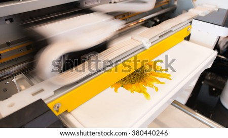Innovation printing. Shirt printing machine. Shirt printer. Fabric printing machine. Printing design shirt. Textile printer machine. Shirt business. Innovation machine. Motion printing. Cloth printer - stock photo