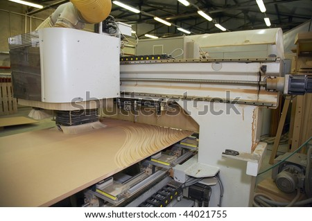 innovation woodworking machinery advanced performance, drilling several surfaces by milling and carving - stock photo