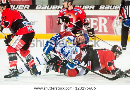 INNSBRUCK, AUSTRIA - AUG 25: Hockey game between HC Innsbruck and Medvescak Zagreb. Curtis Fraser of Zagreb goes down in pain after hard hit, in Olympia Hall, Innsbruck, Austria on August 25, 2012.