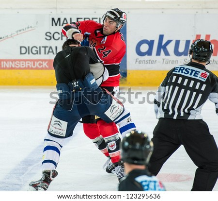 INNSBRUCK, AUSTRIA - AUG 25: Hockey game between HC Innsbruck and Medvescak Zagreb. Fight between Florian Pedevilla and Nathan Perkovich, in Olympia Hall, Innsbruck, Austria on August 25, 2012.