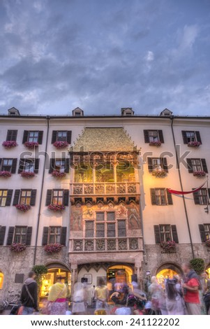 INNSBRUCK, AUSTRIA - AUG 16: The Golden Roof, ornamented with 2,738 fire-gilded copper tiles for Emperor Maximilian I to mark his wedding to Bianca Sforza on Aug 16, 2013 in Innsbruck, Austria. - stock photo