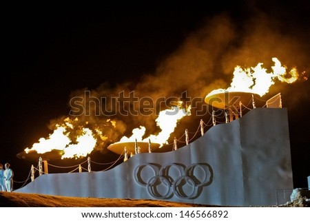 INNSBRUCK, AUSTRIA - JANUARY 13 The olympic fire is burning during the opening ceremony at the Bergisel stadium on January 13, 2012 in Innsbruck, Austria. - stock photo