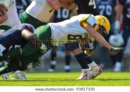 INNSBRUCK, AUSTRIA - JULY 8: WR Ryan Dwyer (#89 Australia) is tackled at the Football World Championship on July 8, 2011 in Innsbruck, Austria. USA wins 61:0 against Australia.