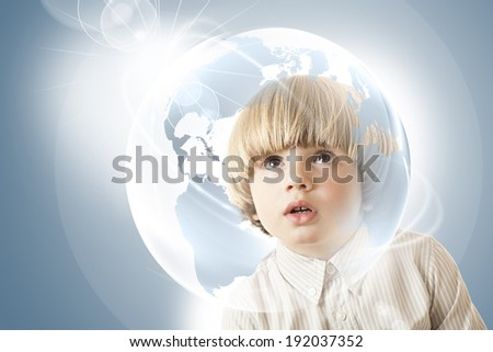 Inquisitive, curious  boy looking with amazement at a globe, dreams of traveling the world Concept of hope, future generation and saving environment legacy for future generation. Young entrepreneur  - stock photo