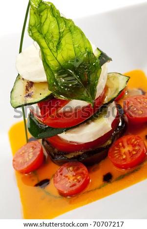 Insalata Caprese - Italian salad, made of Tomatoes, Zucchini and Buffalo Mozzarella Cheese - stock photo