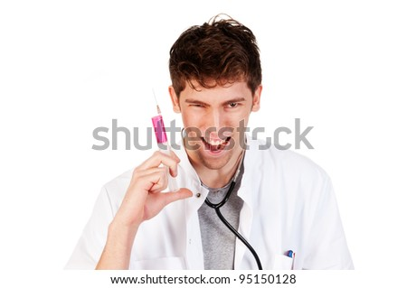 insane laughing doctor  with a needle in his hand - stock photo