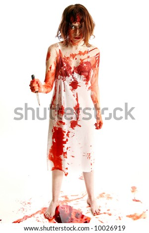 Insane woman killer murderer over white covered in blood holding kitchen knife. - stock photo