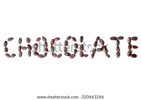 """Inscription """"chocolate"""" made from cacao beans on white background - stock photo"""