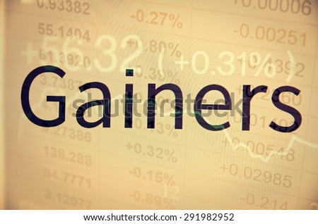 "Inscription ""Gainers"" on PC screen. Financial data as background."