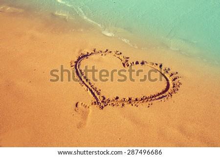 inscription heart on beach sand - stock photo
