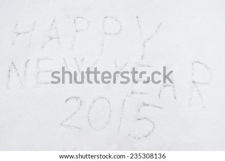 inscription heppy new year 2015 on snow-covered ice, the inscription on the snow - stock photo