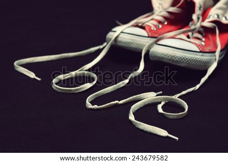 Inscription love with laces shoes - stock photo