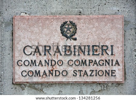 inscription on a marble plaque in a police carabinieri station in Italy - stock photo