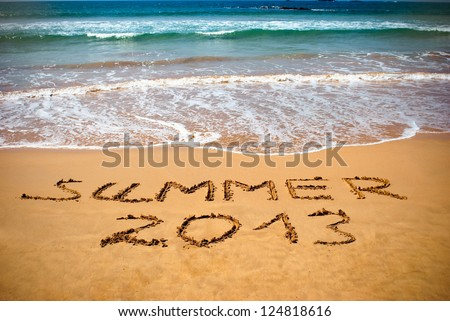 Inscription on wet sand Summer 2013. Concept photo of summer vacation. - stock photo