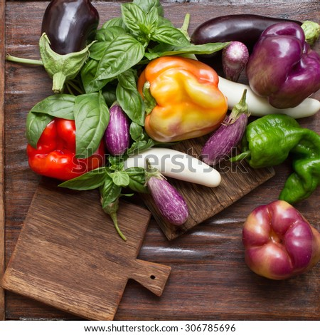 inscription. small eggplant with basil pepper on a wooden background