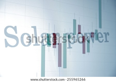 """Inscription """"Solar power"""" on PC screen. Stock chart as background. Business concept. - stock photo"""