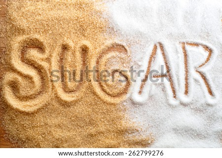 Inscription sugar written in sugar grains - stock photo