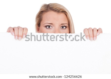 Insecure woman protrudes behind empty white board