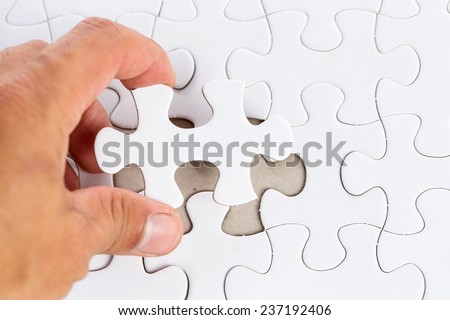 Insert last piece of Jig Saw for completely game - stock photo