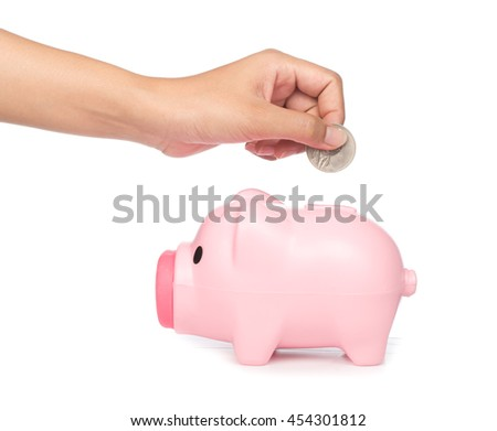 Inserting a coin into a piggy bank isolated on white background - stock photo