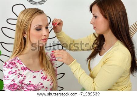 Insertion false eyelashes. Pro at work with client. - stock photo