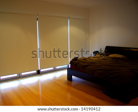 Inside a bedroom at daytime with the blinds down.