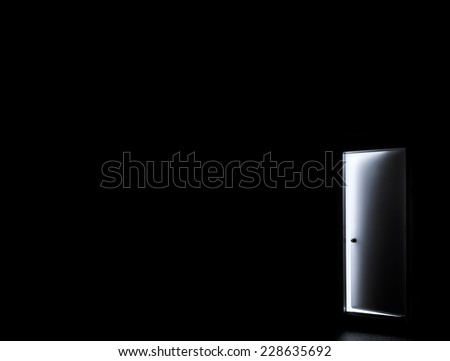 Inside a dark room with opened door - stock photo