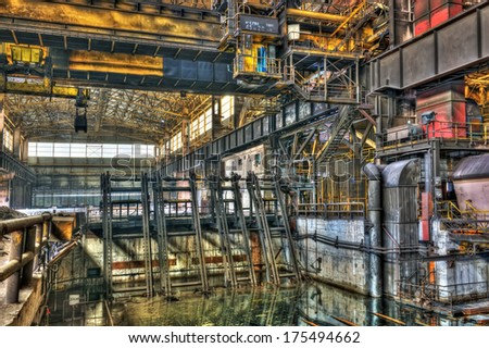 Inside a disused metalworking plant - stock photo
