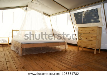 inside a large tent with luxurious furnishings - stock photo